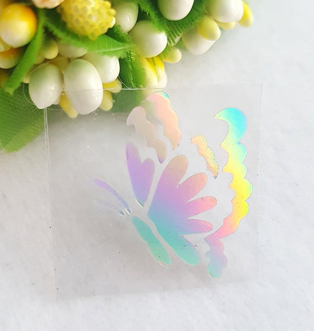 Бабочка термотрансферная наклейка голограмма 1шт +/-20*23мм радужный