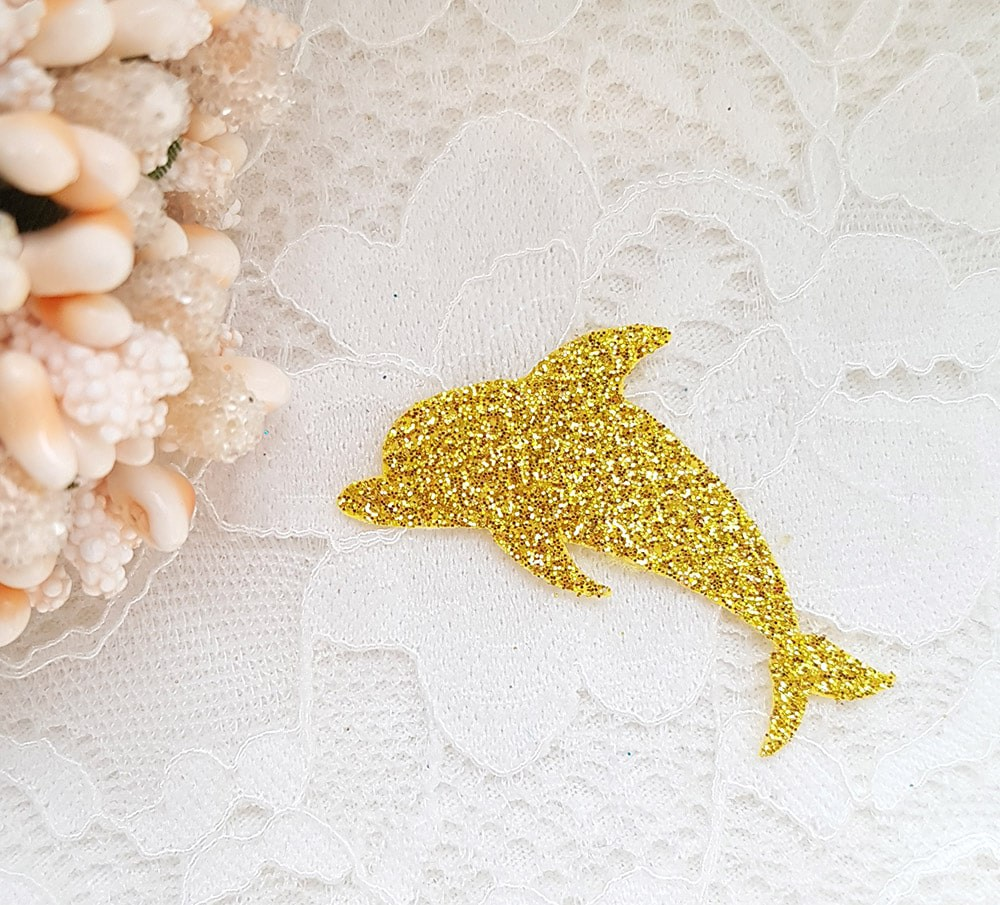 Дельфинчик из тонкого блестящего материала 40*30мм золото